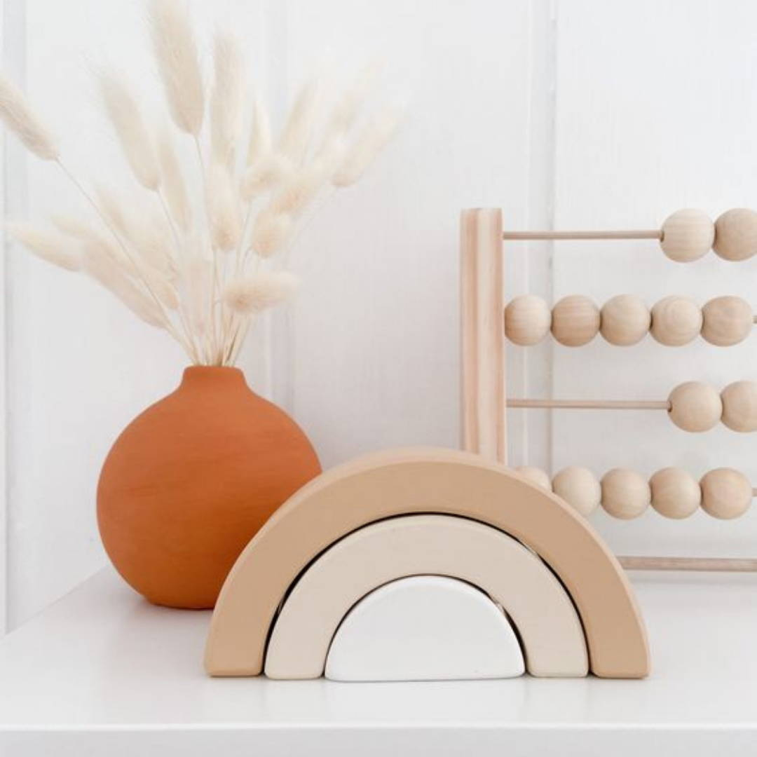 Neutral wooden toys with pop of colour for nursery decor