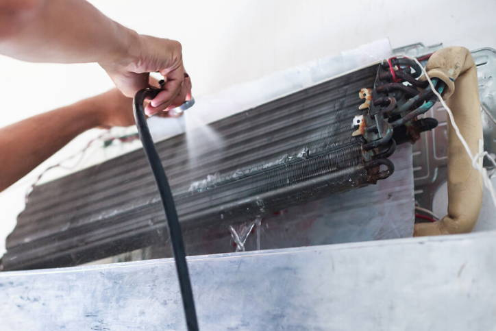 Mold Being Cleaned From Appliance Coils