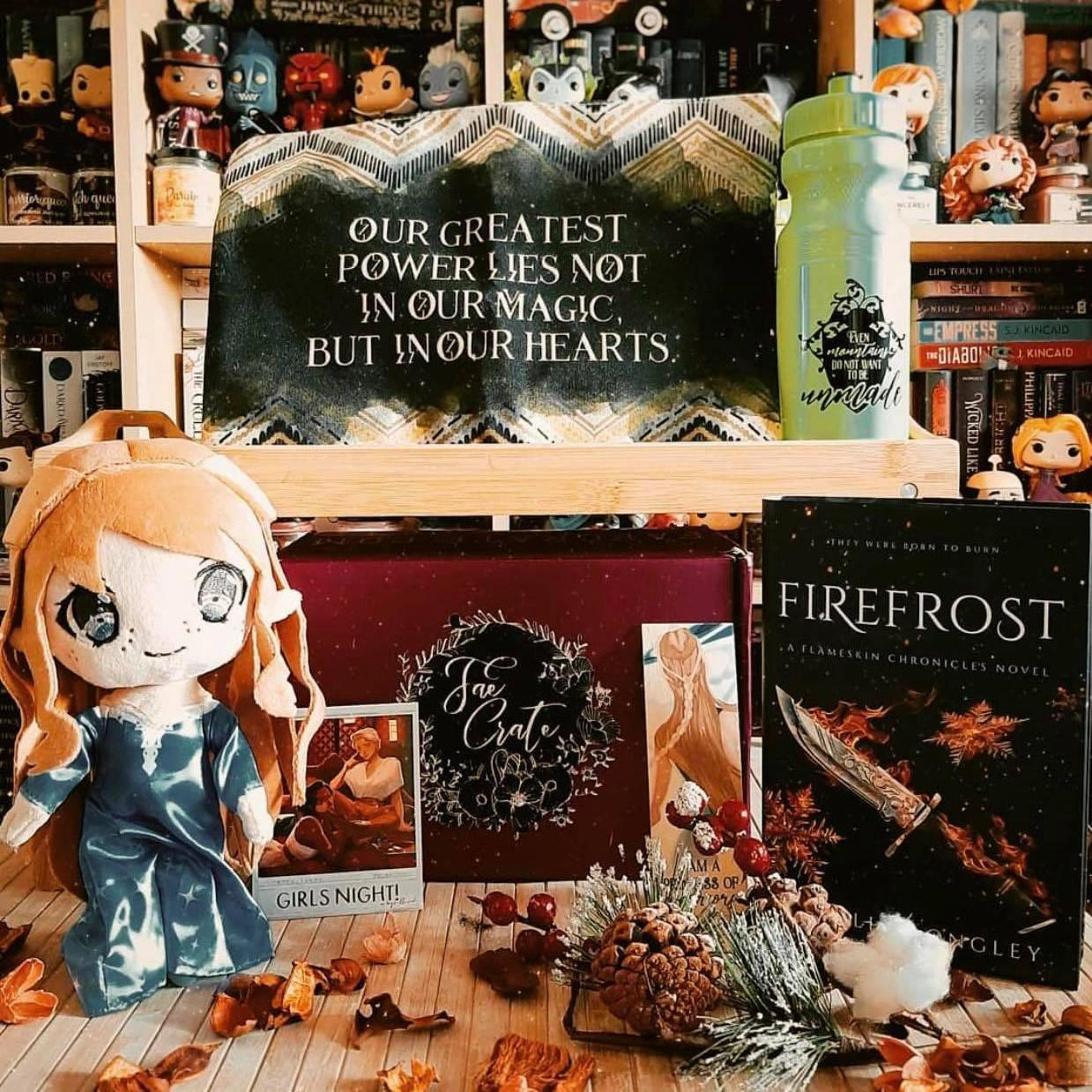 October 2020 This Means War box theme includes exclusive High Lady Plushie, Firefrost by Camille Longley, The Guinevere Deception Water Bottle, Kingdom of Souls Zipper Pouch, Rin/Ares Olympian Print, and Sheilded Woodmark.
