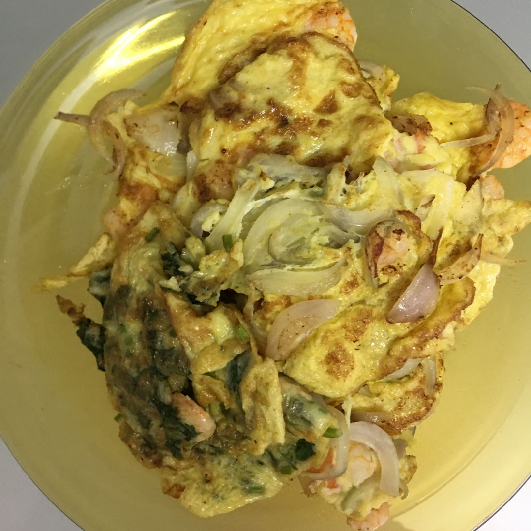 Onion and coriander omelette.  I make 2 different types because not everyone in the house take coriander. ;))
