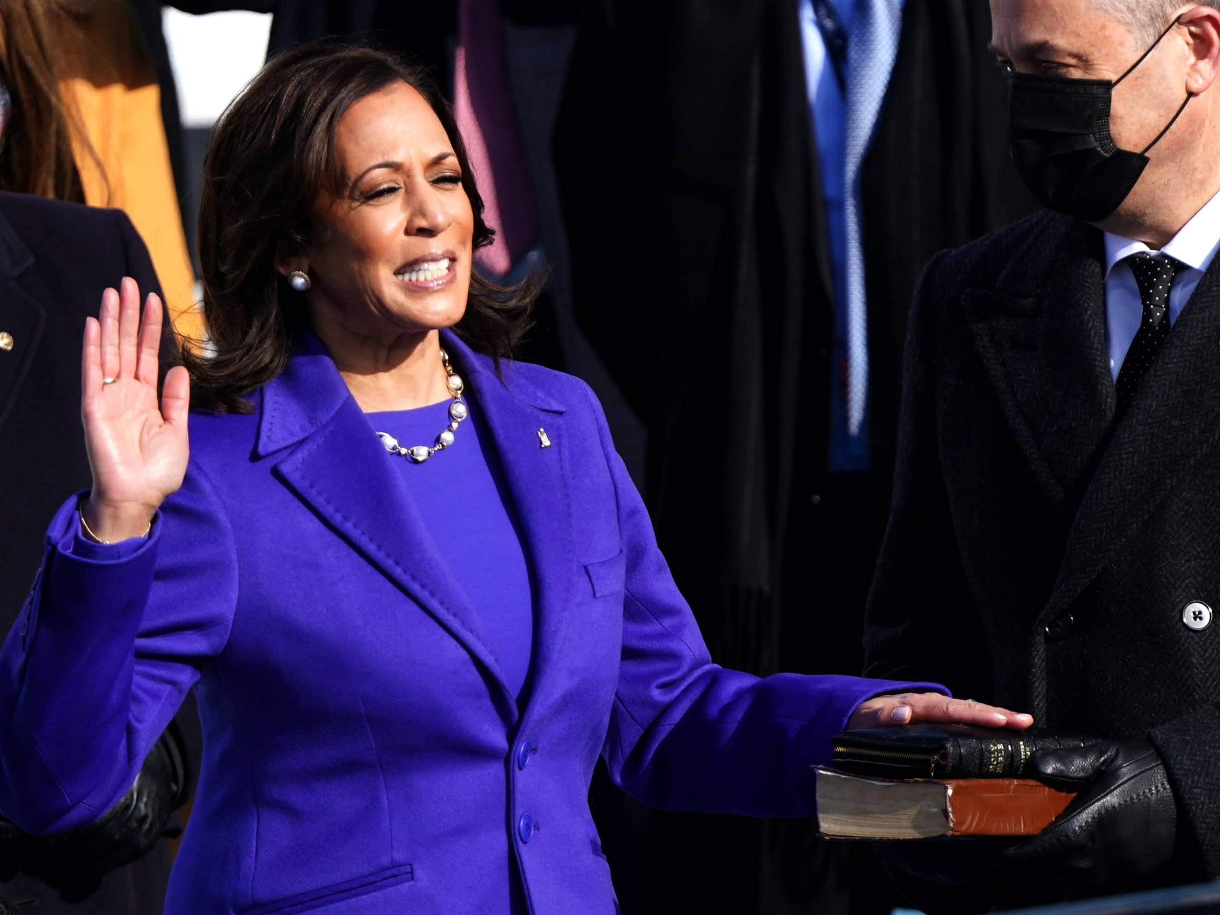 Kamala Harris is the first woman in history to be sworn in as Vice-President of the USA wearing a purple coat
