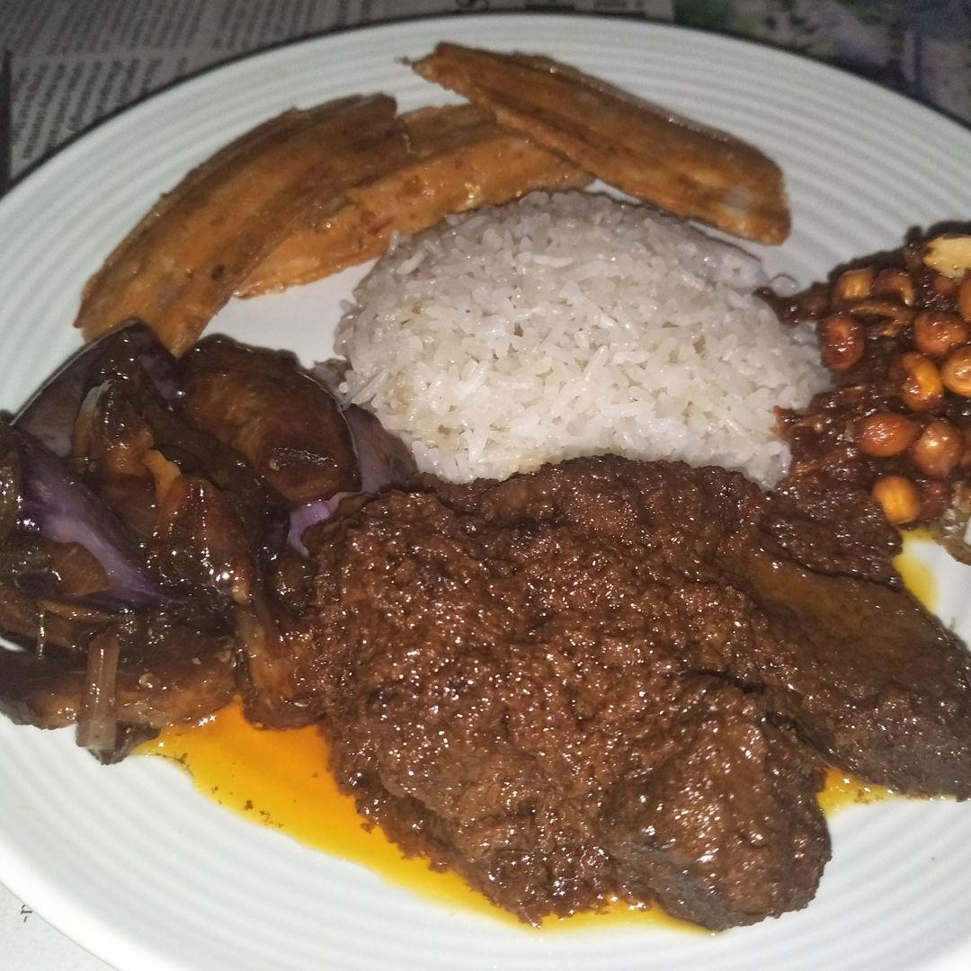 beef rendang, Terong Kecap Pedas, conconut nasi lemak rice, sambal peanuts and ikan bilis + otah - YUMMY!