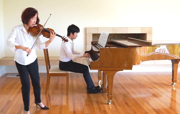 Bing Wang performs at home