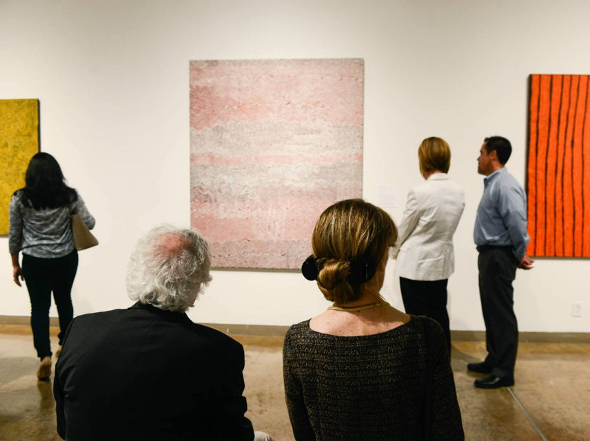 People sitting in a gallery.