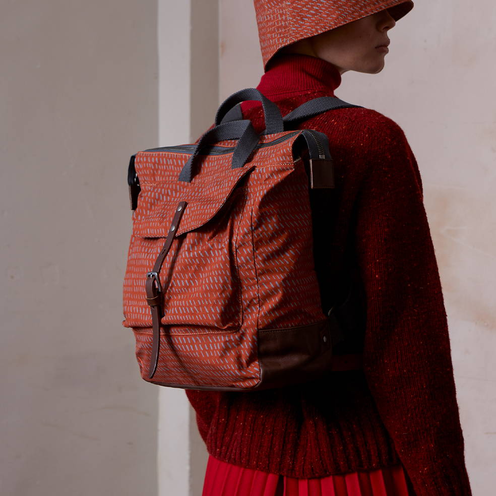 Frances Waxed Cotton Print Backpack in Rust