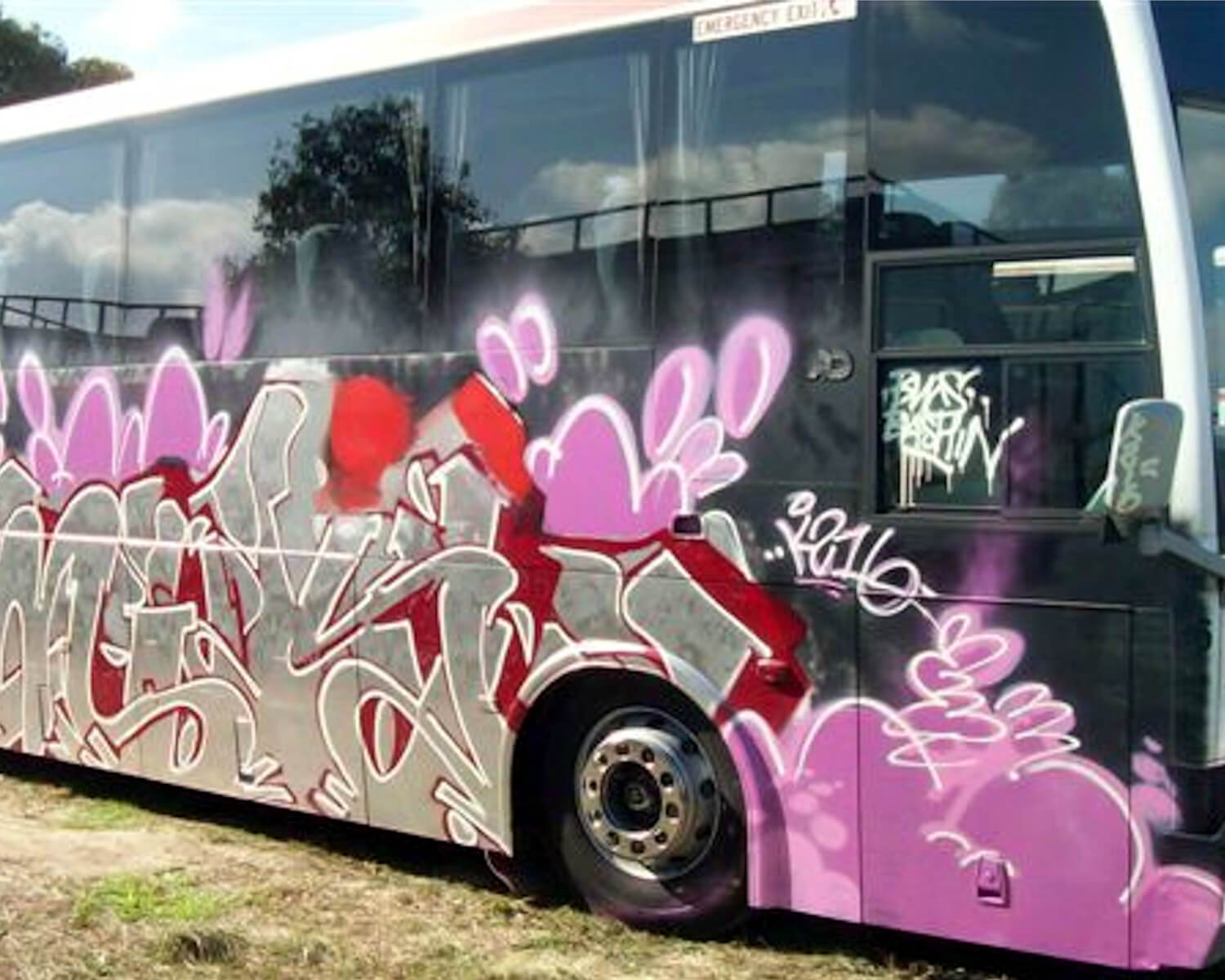 removing graffiti from a bus
