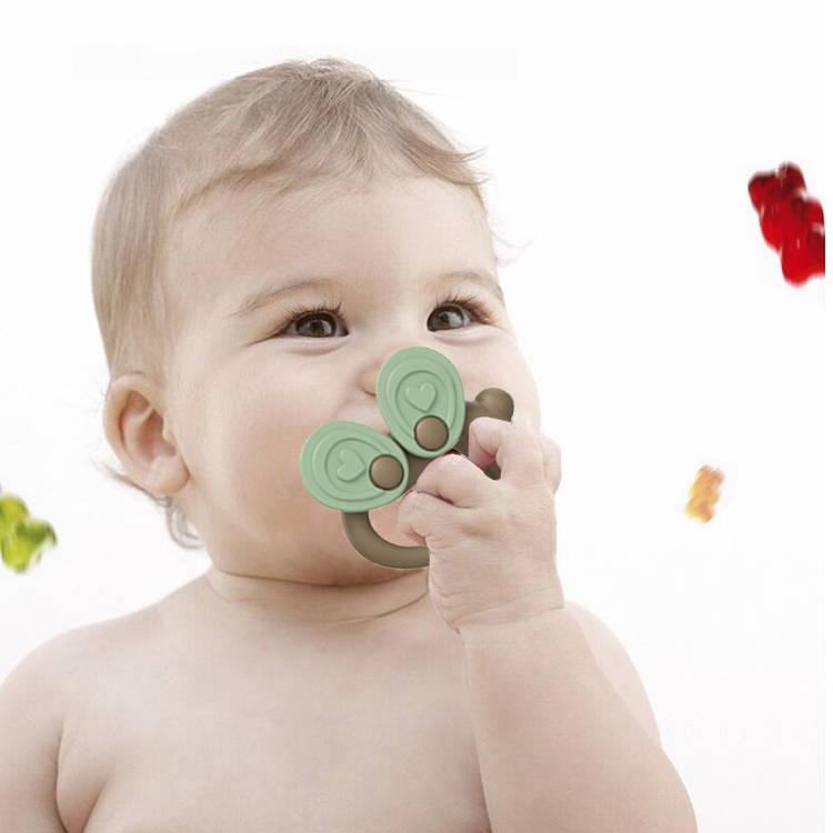 SuperTots baby milk powder dispenser multi-nozzle design with powder being poured into bottle