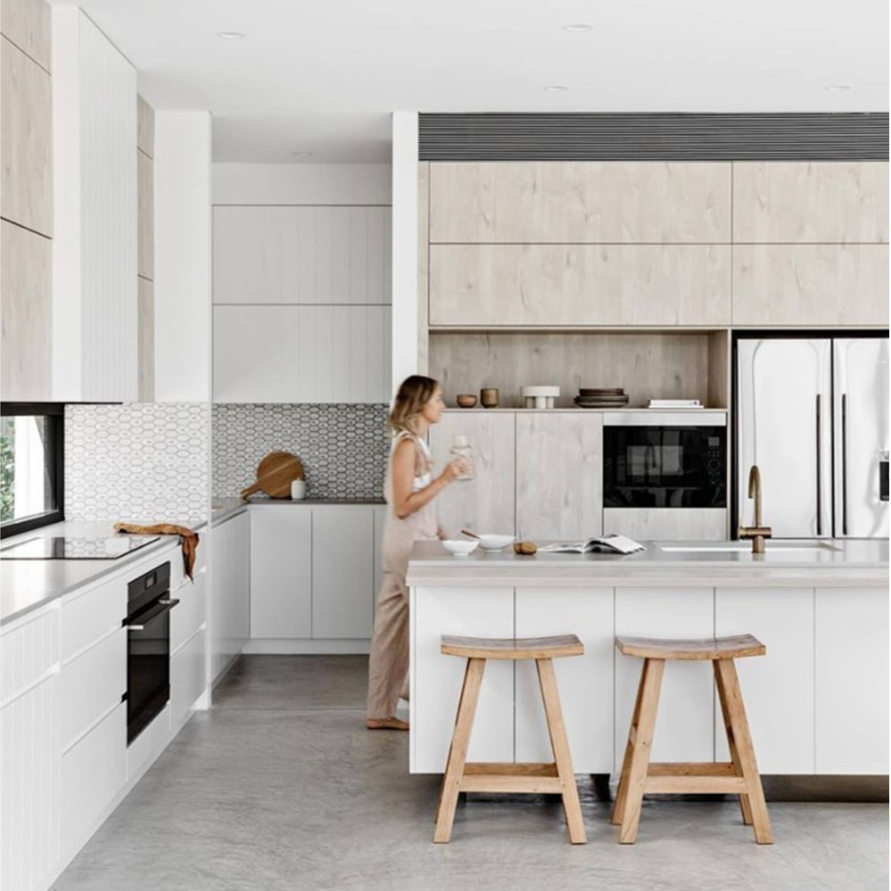 Timber Stools by INARTISAN - A kitchen setting with timber stools at the bench