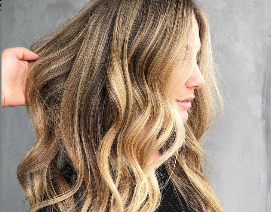 side view of a woman with highlighted wavy hair