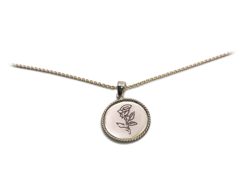 yellow gold medallion pendant with an engraved rose