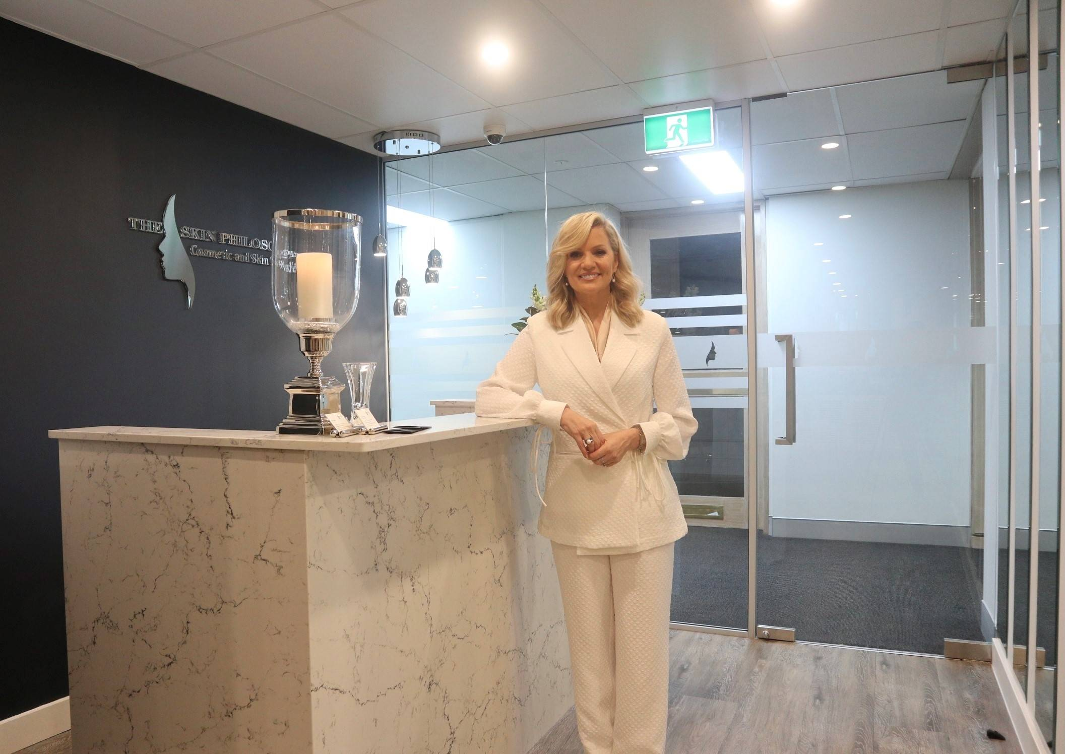 girl using face cleanser at skin clinic Sydney