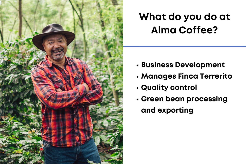Man smiling beside Coffee Trees