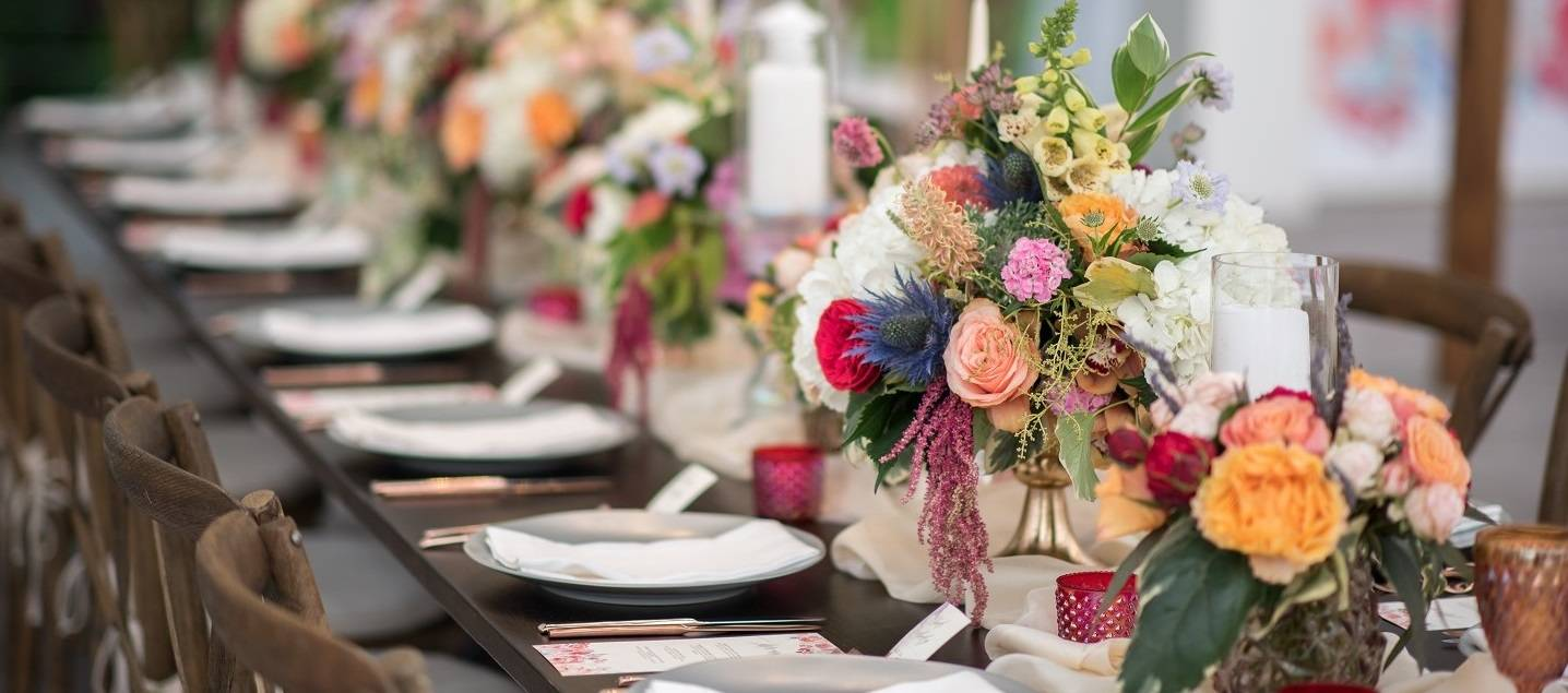 Long Farm table centerpiece with candles at a Pittsford, NY wedding