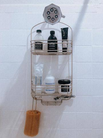 photo of Davines products in a hanging shower caddy in a shower