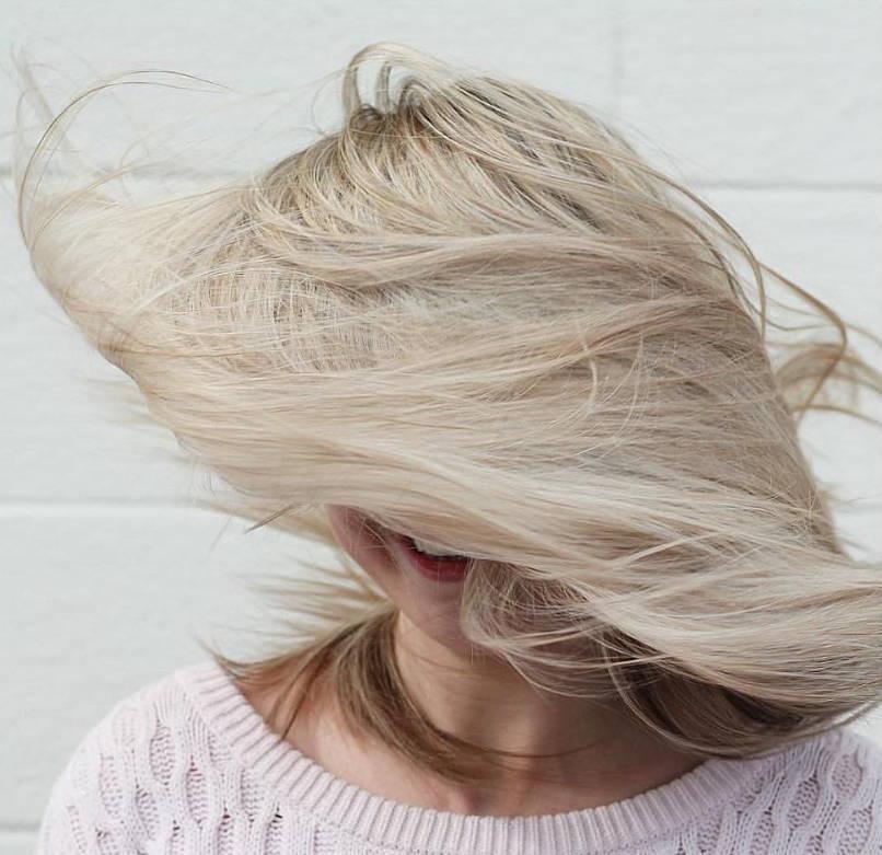 blonde woman shaking her hair around