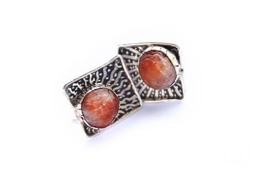 Серебряные запонки с солнечным камнем