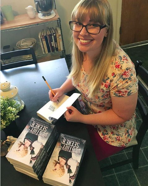 Whitney McGruder, debut author of Destiny Seeker, signing paperback copies of her book // read the interview on www.bridgidgallagher.com
