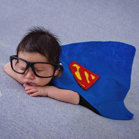 preemie baby as superman halloween costume in the NICU