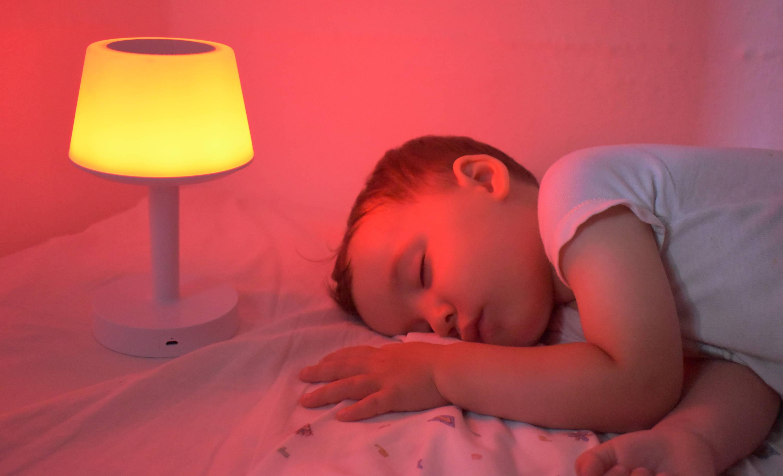 Baby sleeping next to Baby Mood Lamp