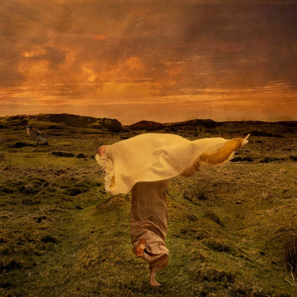 Individual running across grassy landscape to Jesus' empty tomb. A flapping robe covers the individual's face.