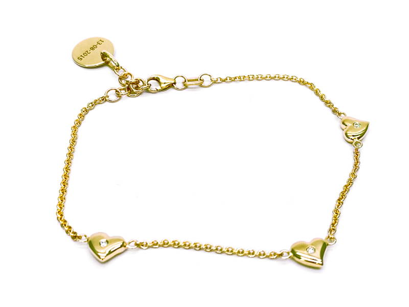 Yellow gold necklace with 3 hearts with small diamonds in the center spaced apart from each other