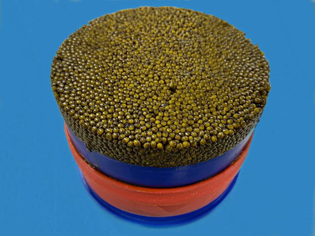 Kilo tin of caviar on blue background