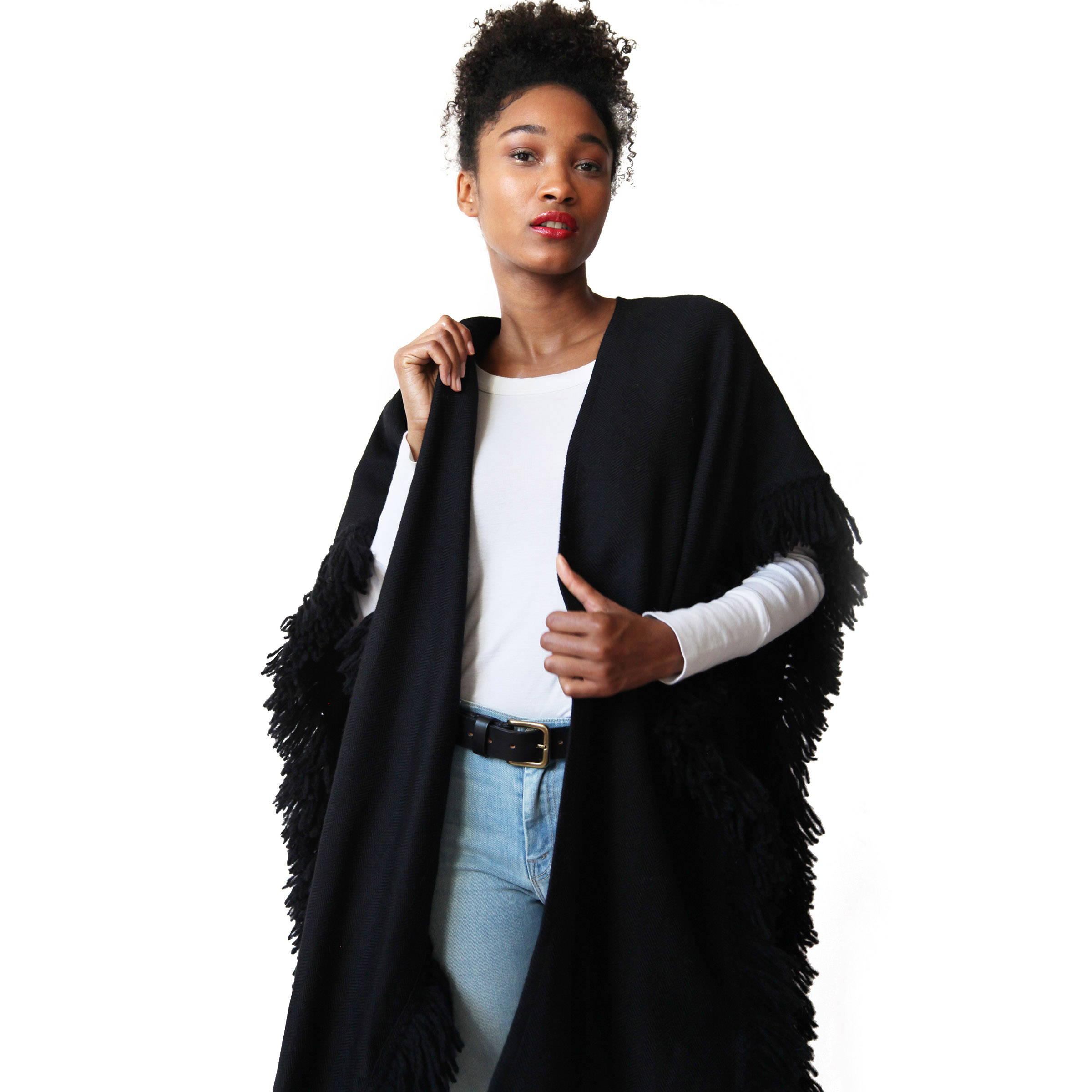 Woman wearing Stick & Ball Handwoven Alpaca Fringe Ruana Wrap in Black