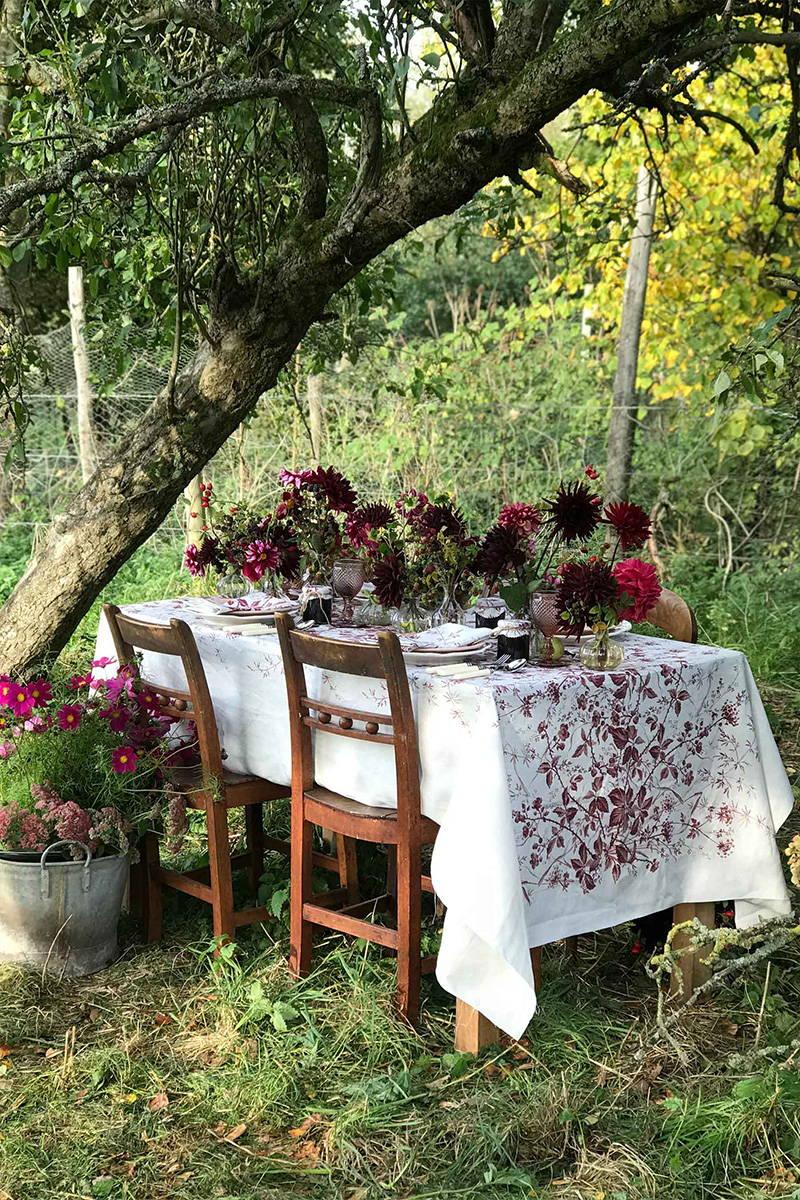 Blackberry Print Linen Tablecloth by YOLKE with Kitten Grayson Flowers in a field