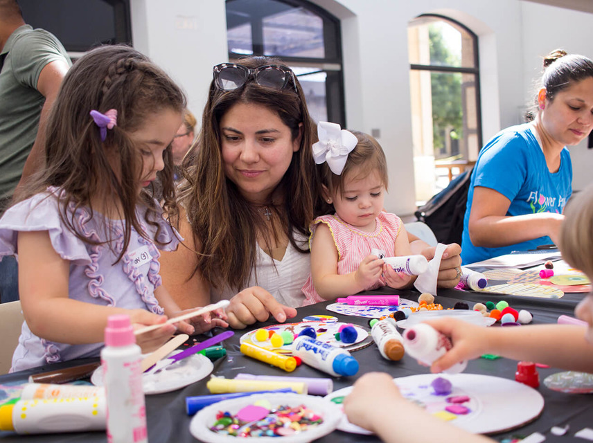 caregiver helping children make art