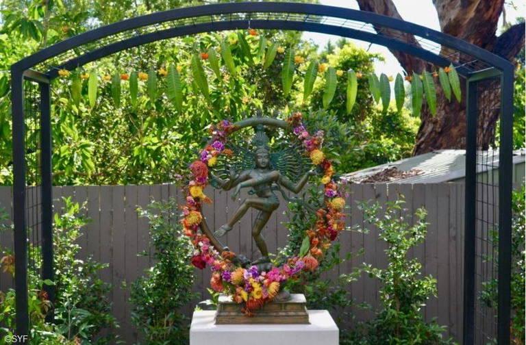 Statue of Shiva with Flower Garland in Sydney Ashram Garden