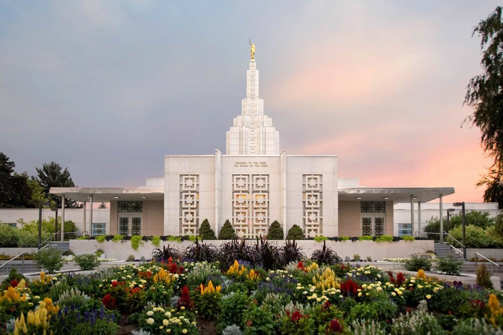 Photo of Idaho Temple behind colorful flowerbed.