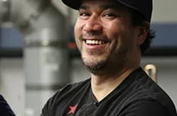 Jason Casey is laughing while  at the mash tun.