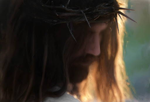 Up-close portrait of Jesus wearing the crown of thorns. His face his mostly maksed in shadow.