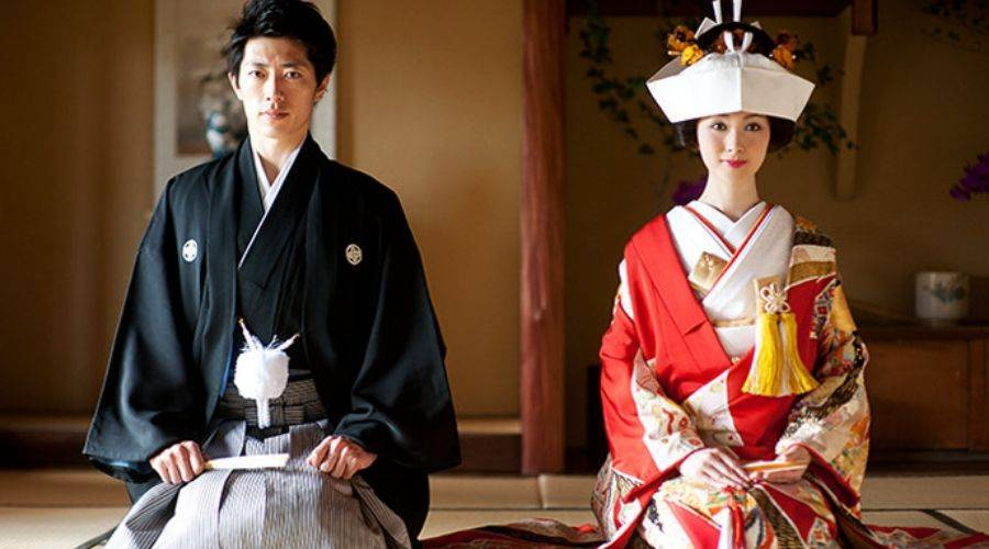 couple in traditional japanese wedding outfits, kimono in red and white