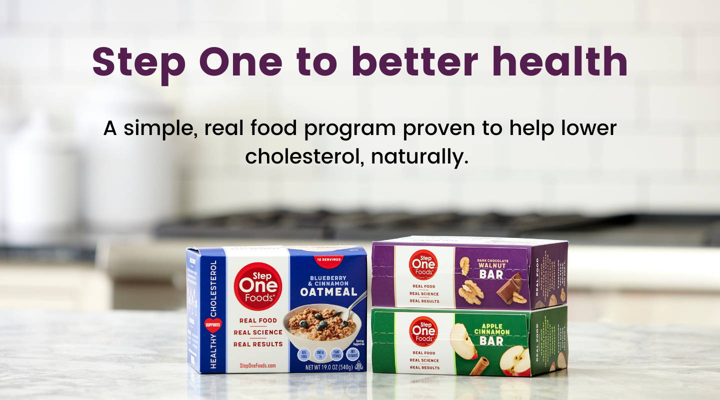 Picture shows Step One Foods product boxes on a white countertop in a kitchen. Text at the top of the image reads Step One to better health. A simple, real food program proven to help lower cholesterol naturally.