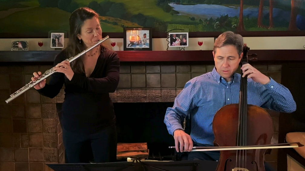 Associate Principal Flute and her cellist husband perform music by Villa-Lobos in their living room.