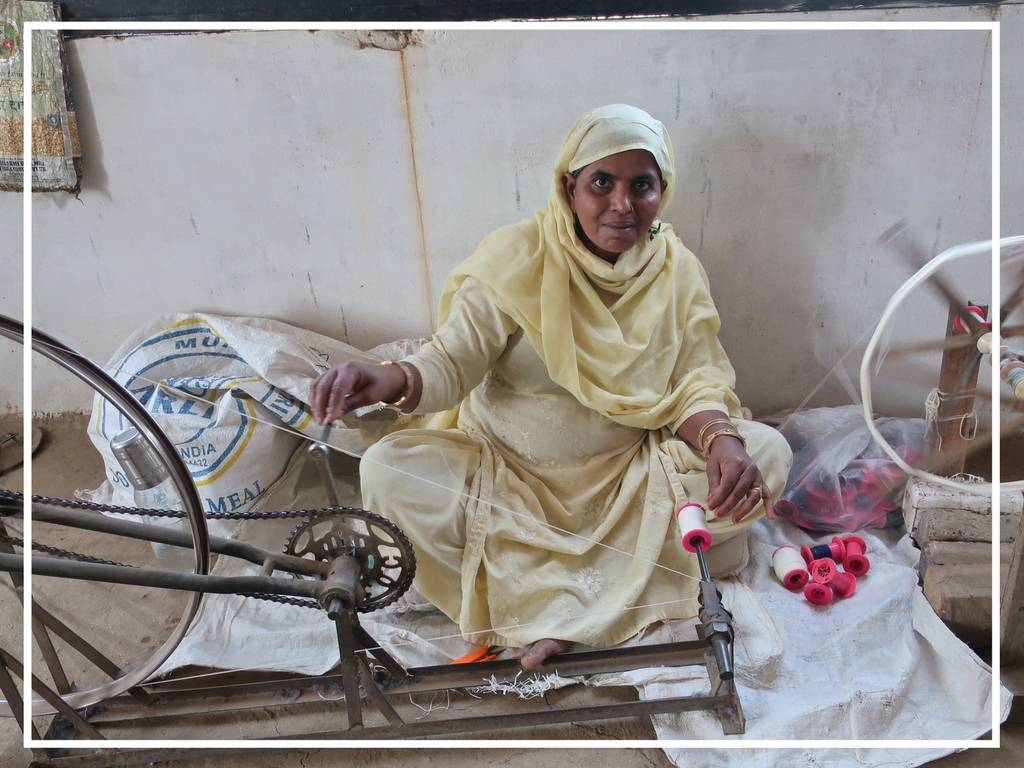 woman spinning yarn in india for khadi