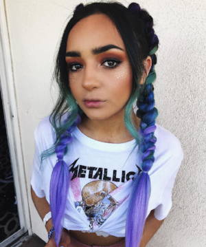 Braids are back and this time with a colourful twist. We love the addition of the soft curls. Plus, no Coachella look would be complete without some glitter.