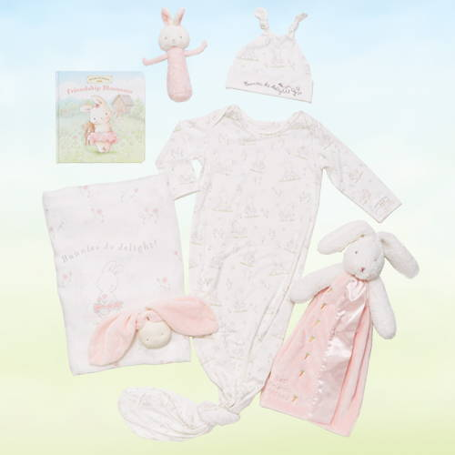 Image of baby in pink hooded bunny blanket