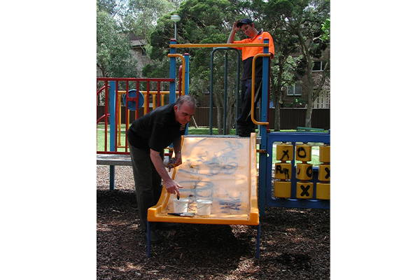 removing graffiti from playground