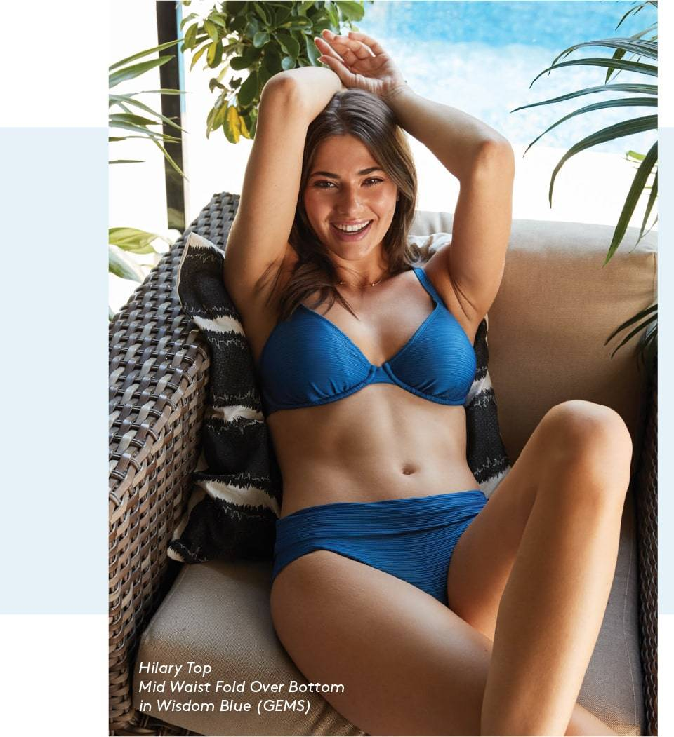 Sofia is wearing SKYE's Hilary top and Mid Waist Fold Over bottom in Wisdom Blue from the Gems collection.