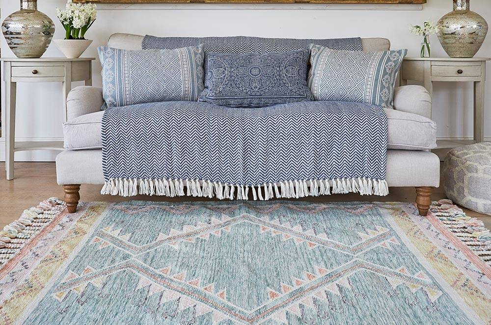 Andalucia Paloma Rug with navy herringbone blanket and kalkan cushions