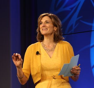 Jill Schlesinger and her yellow dress contributed energy and smart humor.