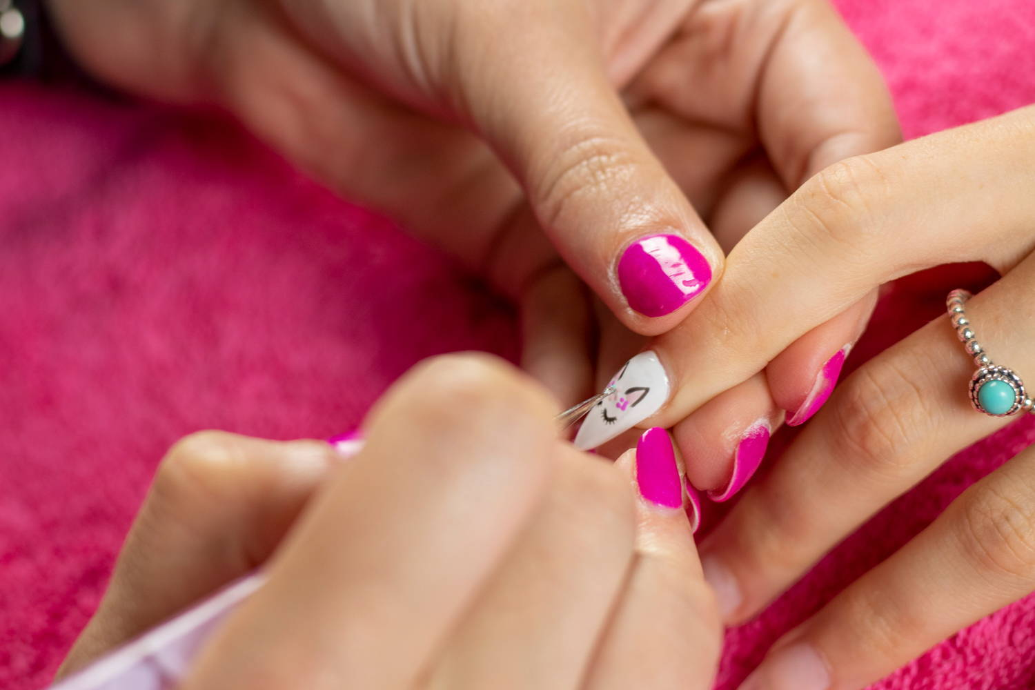 Unicorn nail art detail being painted onto a nail using ORLY GelFX Gumdrop, Lift The Veil and Scenic Route