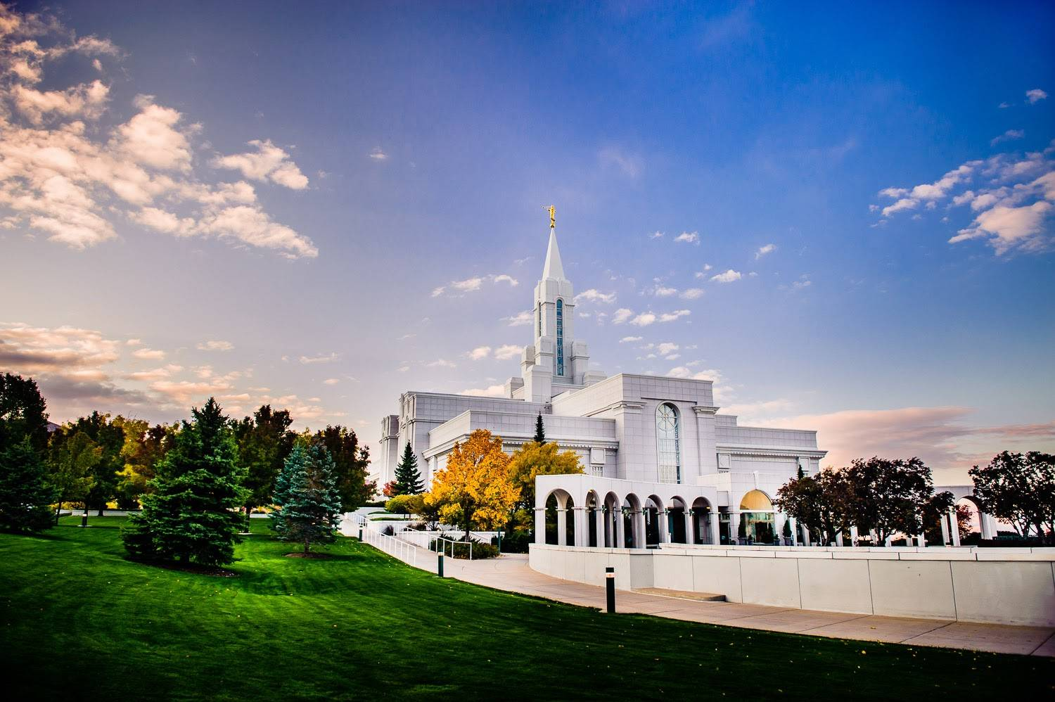 Photo of Bountiful Utah LDS Temple against clear skies and yellowing trees.