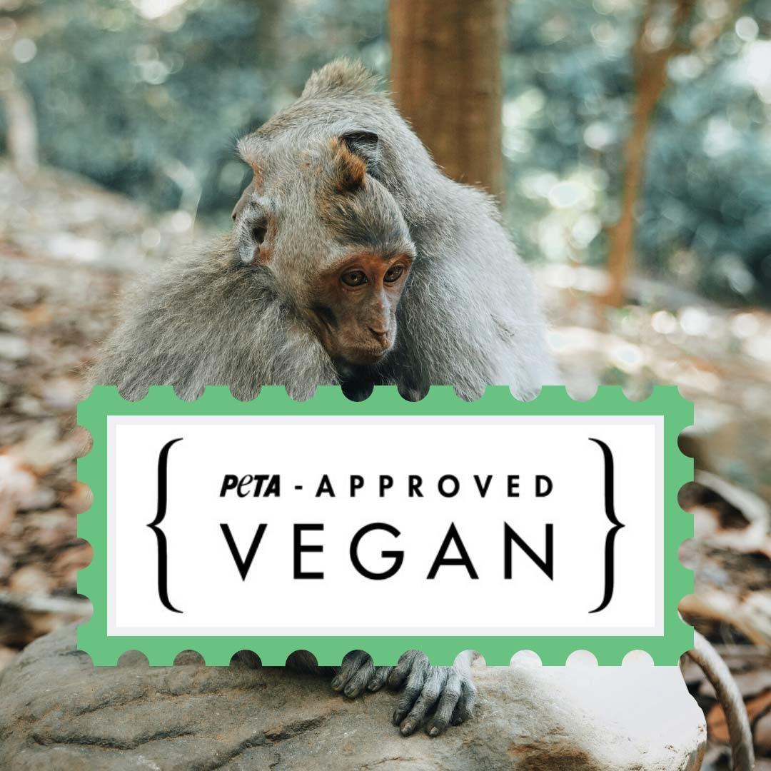 L'image comporte le label de Peta-Vegan approved ainsi qu'une photo en arrière-plan d'un couple de singe.
