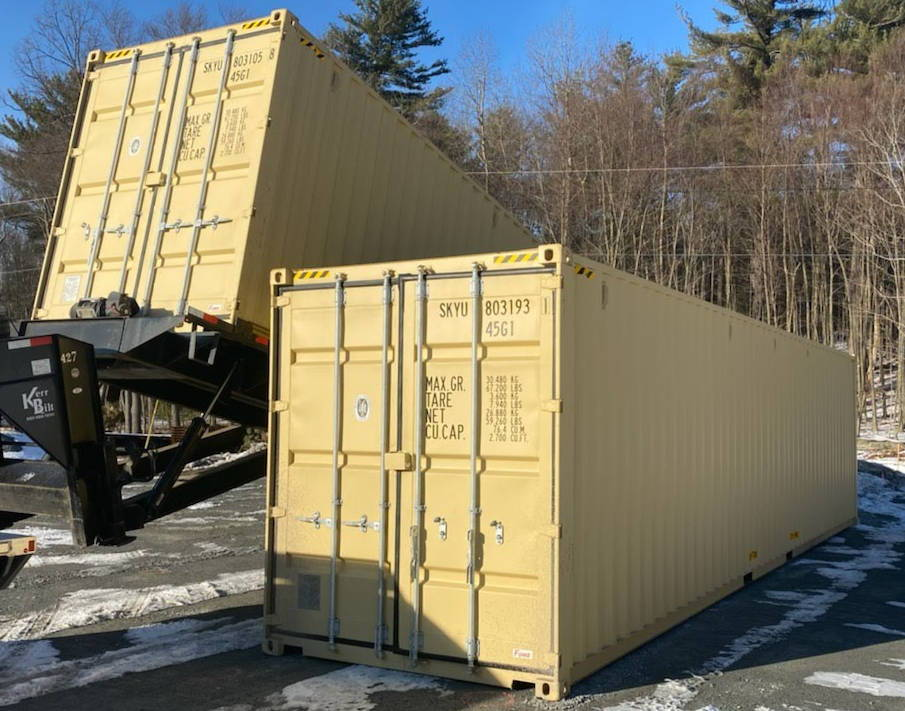 40 foot high cube shipping containers being unloaded