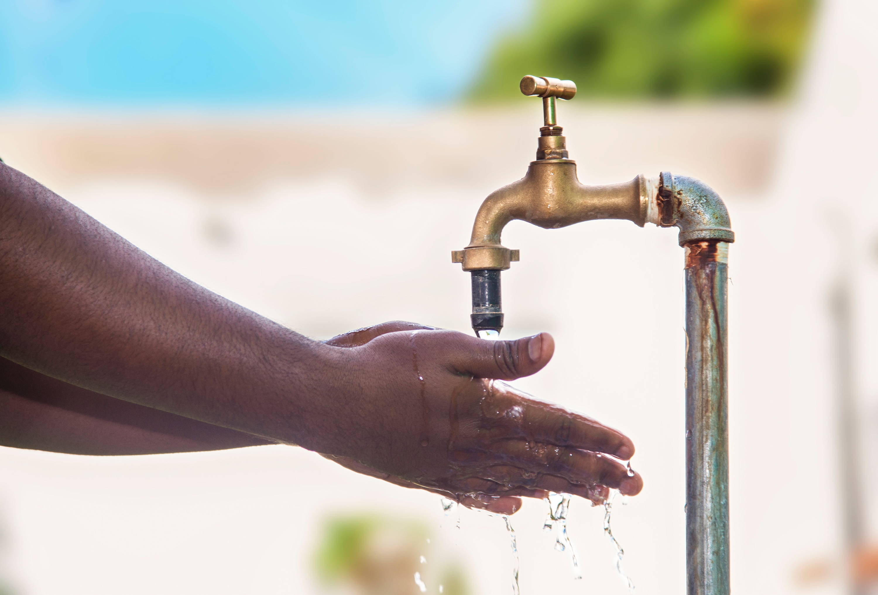 Hands with outdoor tap