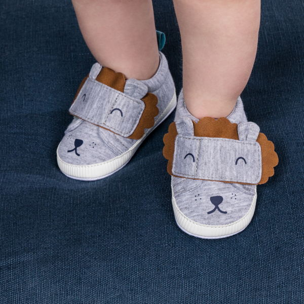 child with infant boy shoes