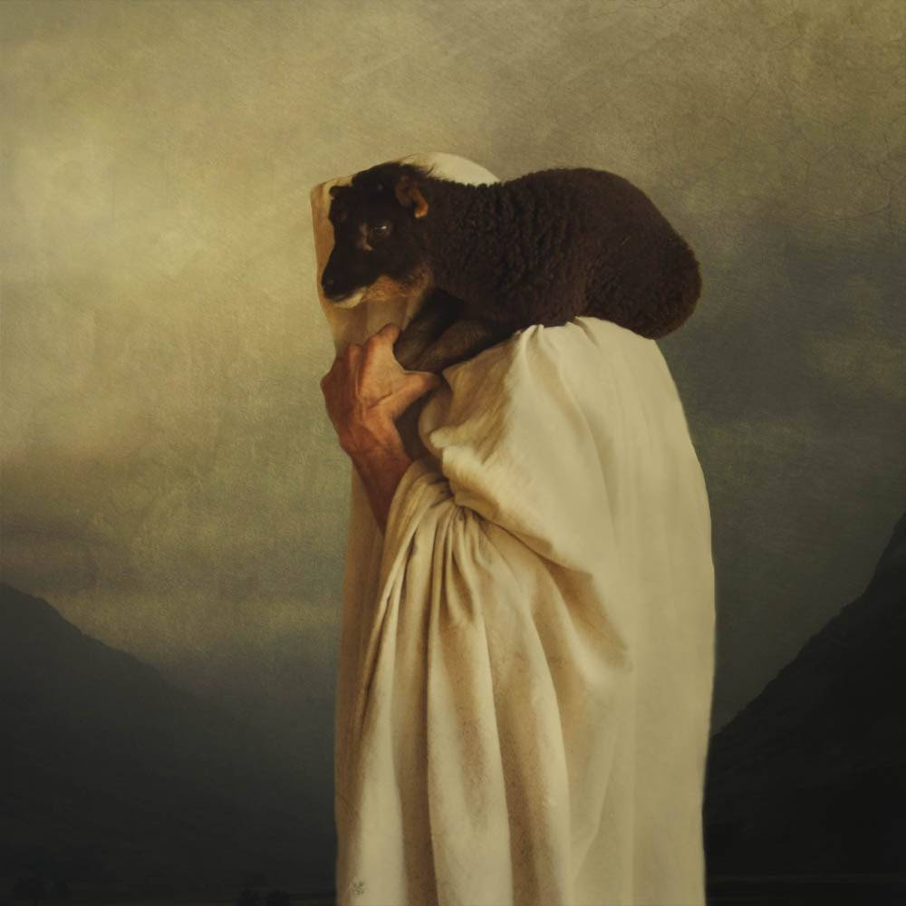 Image of Jesus carrying a black sheep on his shoulders.